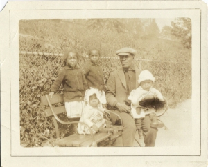 Grandfather William Palmer with 4 of his children at Mt. Morris Park in 1926.  My Dad is not in the photo because he was not born until 1930.