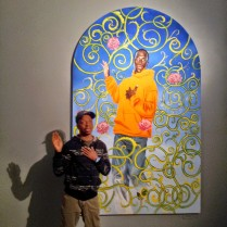 My Brother Stephen standing next to a Kehinde Wiley painting at the Brooklyn Museum