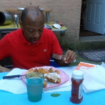 Stephen eating outdoors