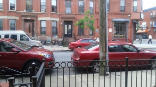 THREE RED CARS